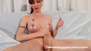 Oiled and stroking that huge tranny cock
